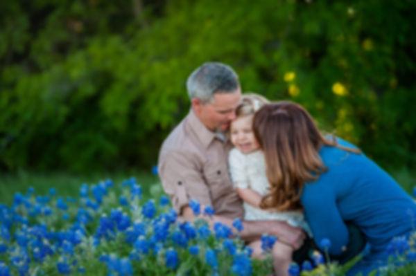 gorgeous fmily in bluebonnets, portrait in texas bluebonnets