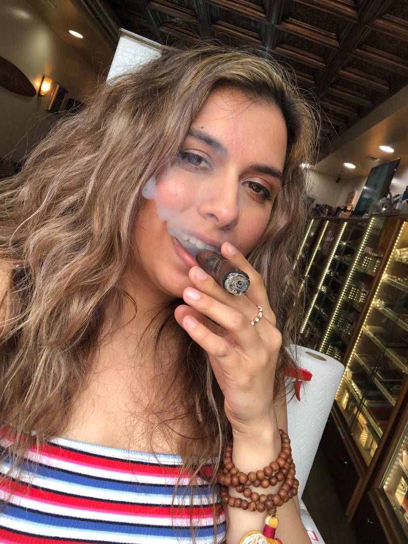 Cigar girl Marisa enjoying a smoke!