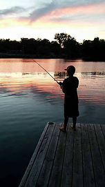 kid fishing off peir.jpg