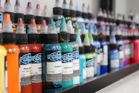A close up of Tattoo Ink Bottles