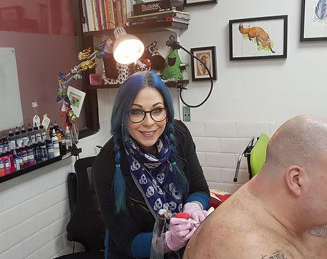 Karen Maxey Tattoo Artist tattooing a client