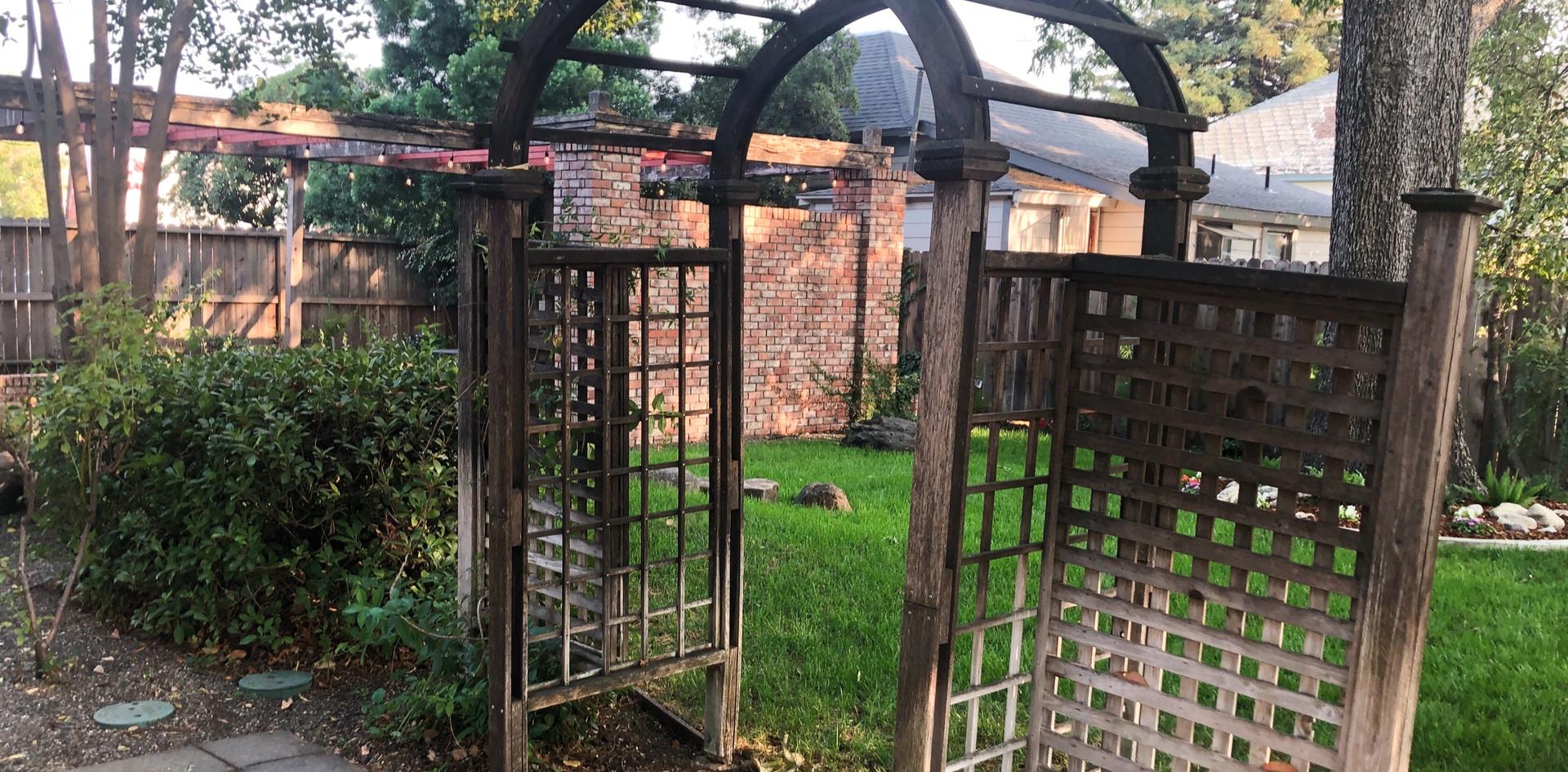 Green Grass, Aged Brick, Rustic Arbor