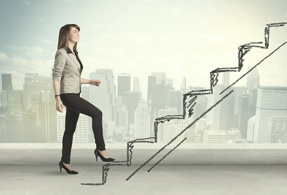 Corporate woman going up stairs
