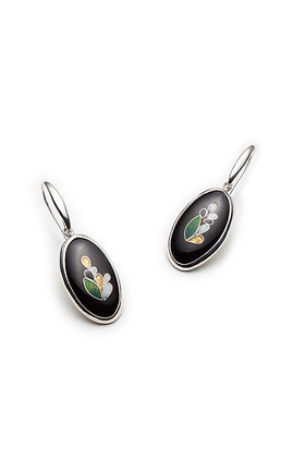 Black oval earrings with floral designs