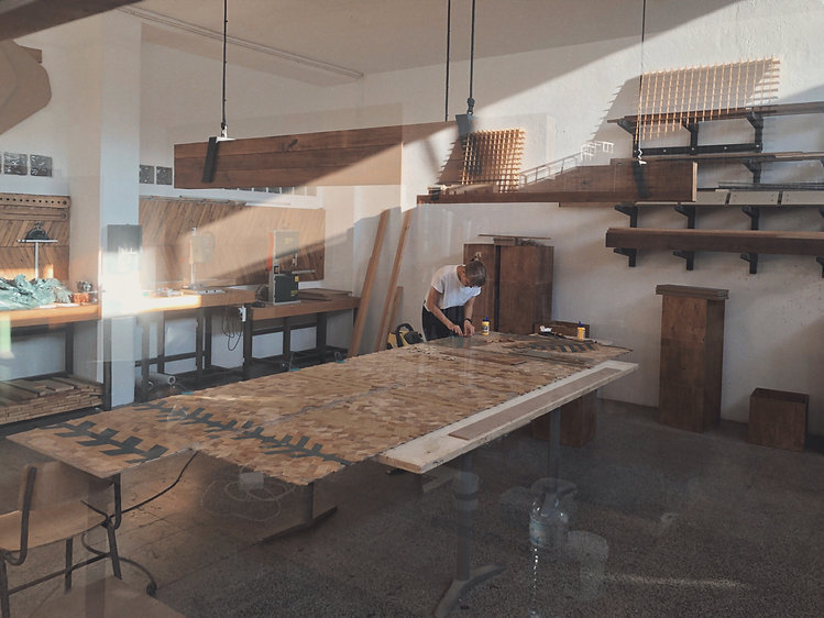 suatainable creative studio view with wooden panels