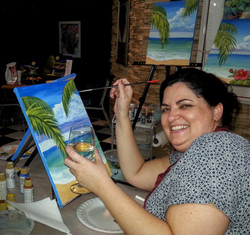 Happiness is wine and a paint brush