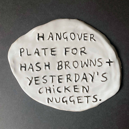 Hangover plate for hash browns + yesterday's chicken nuggets.