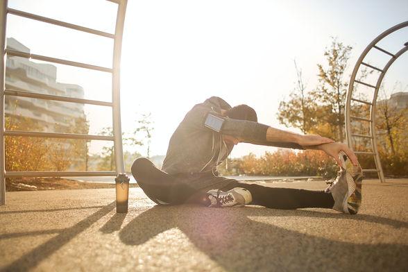 flexible-sportsman-stretching-on-sports-