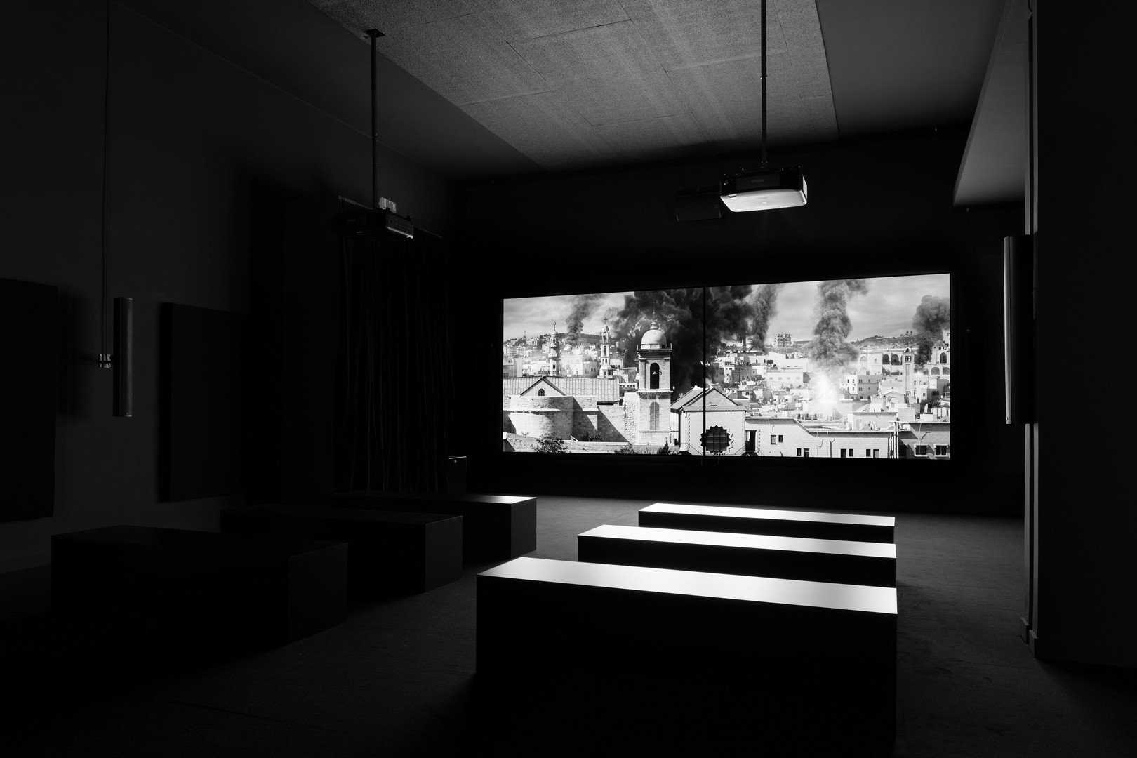 Larissa Sansour and Søren Lind.Installation view of In Vitro, 2-channelblack and white film. 27 mins 44 secs,2019. Photo by Ugo Carmeni.