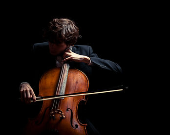 musician playing the cello. Black backgr