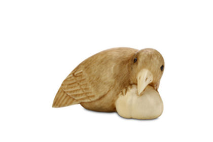 AN-IVORY-NETSUKE-OF-A-BIRD-Meiji-period_