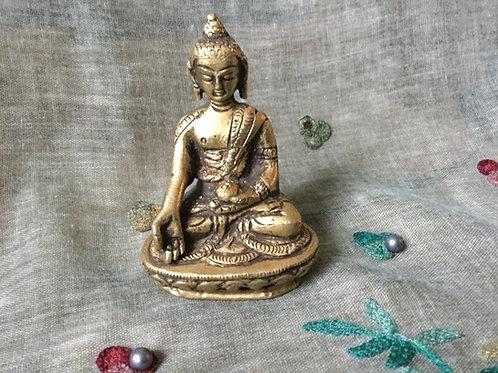 Statue of Buddha doing generosity mudra
