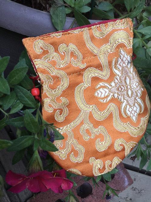 Mala pouch in orange satin