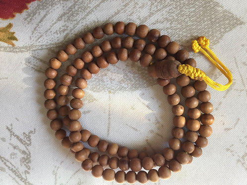 Buddhist mala in sandalwood beads