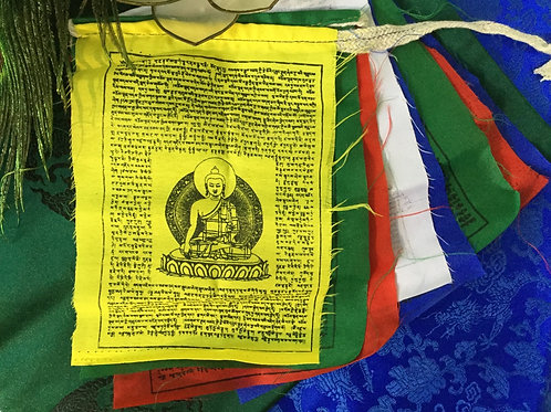 Tibetan Buddhist prayer flags set with Buddha Shakiamuni