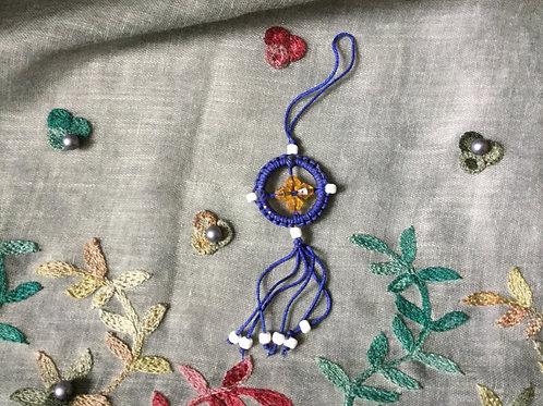 Mini Dharma wheel in blue strings, handmade in Tibet