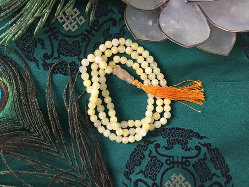Buddhist mala with yellow natural cornelean beads