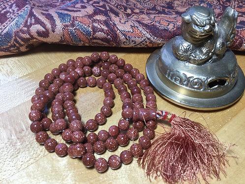 Mala bouddhiste de grains de Pierre de soleil