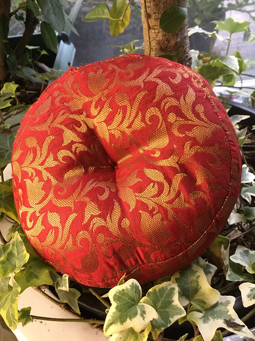 Cushion for singing bowl, round and red