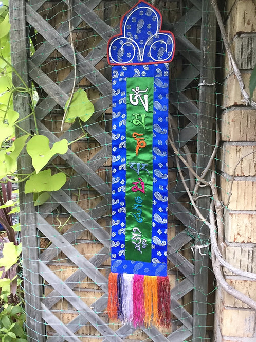 Banner with Compassion Mantra in green and blue silk and coton fabric