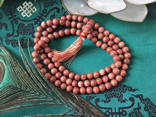 Buddhist mala with Sun stone (quartz beads)