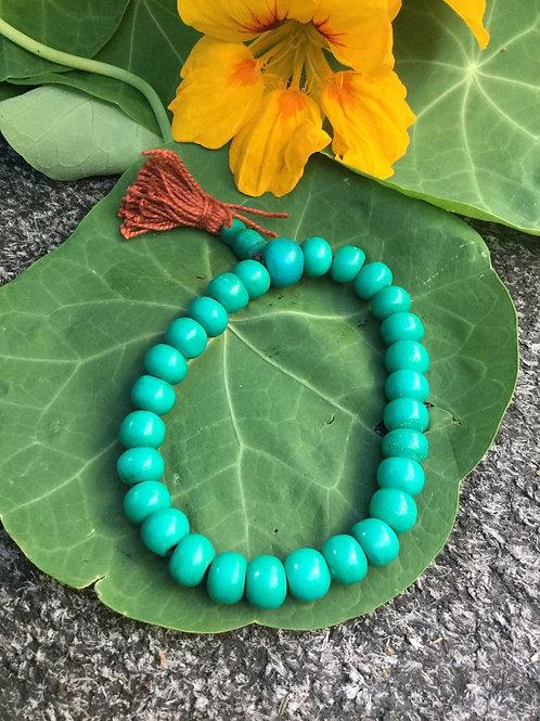 Buddhist whrist mala with green bone beads
