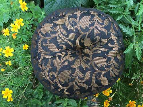 Round cushion in brown and gold satin for singing bowl