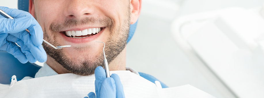 Young man at the dentist. Dental care, t