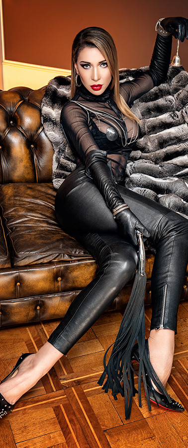 Mistress on chesterfield sofa