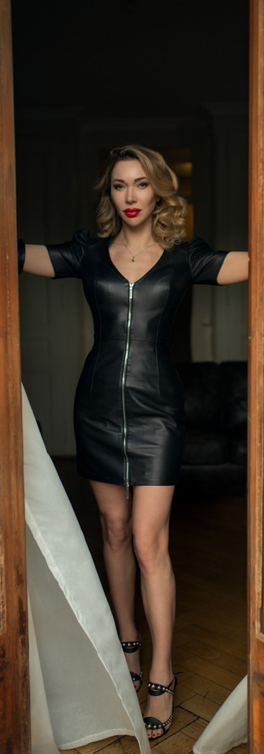 Mistress in front of the window