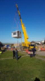 Modular unit being craned onto site