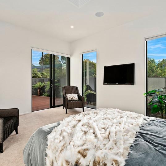 Idris Road, Master bedroom view to deck.