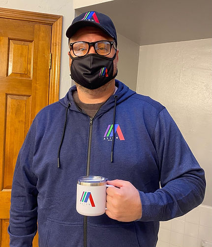 An attendee wearing ALL the branded swag: hoodie, hat, glasses, and even the mug!