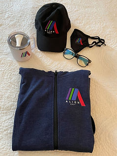 A mug, hat, mask, blue light glasses, and a hoodie, all branded with ALIGN