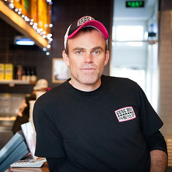 Photo of Jade Gray founder of Gung Ho Pizza, with a hat on