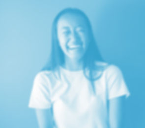 Blue photo of a young asian woman laughing with a white t-shirt on