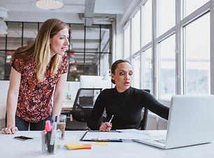 Female executives working together on ne