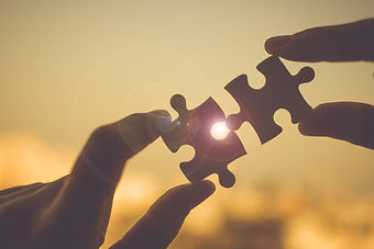 Silhouette Woman hands connecting couple puzzle piece against sunrise effect, businesswoma