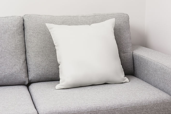Blank white pillow on a couch..jpg