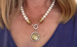 Pearls with coin pendant at clasp