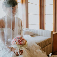 Lovely bride with our bridal bouquet - a