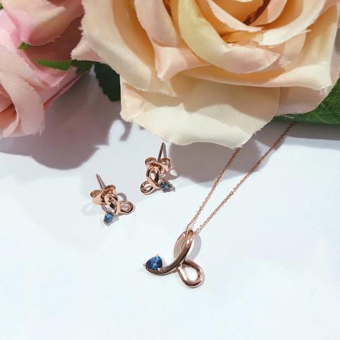 9ct Rose Gold Set with Sky Blue Topaz