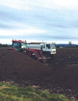Chicken manure compost being spread at gatton in queensland