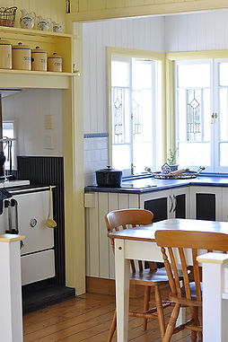 The self-contained kitchen at Sheepwash Cottage on Montrose Farm is warm and bright