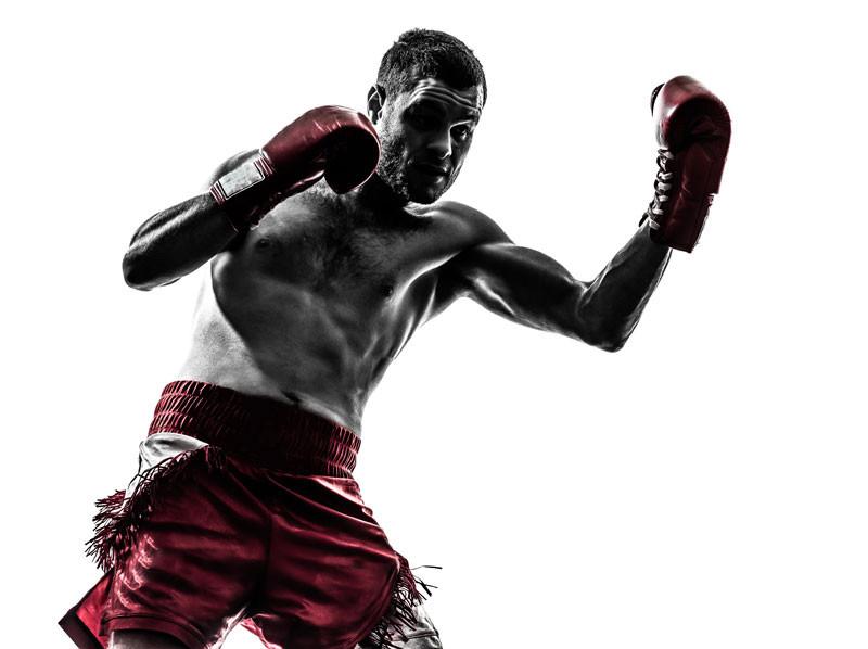 one-man-exercising-thai-boxing-silhouett
