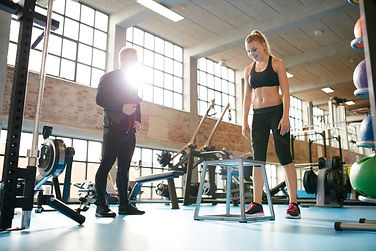 woman-exercising-with-a-personal-trainer