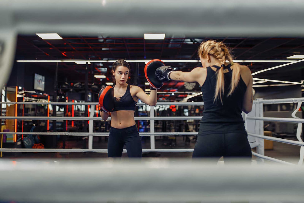 two-women-boxing-on-the-ring-box-workout