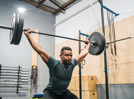 crossfit-athlete-doing-exercise-with-a-b