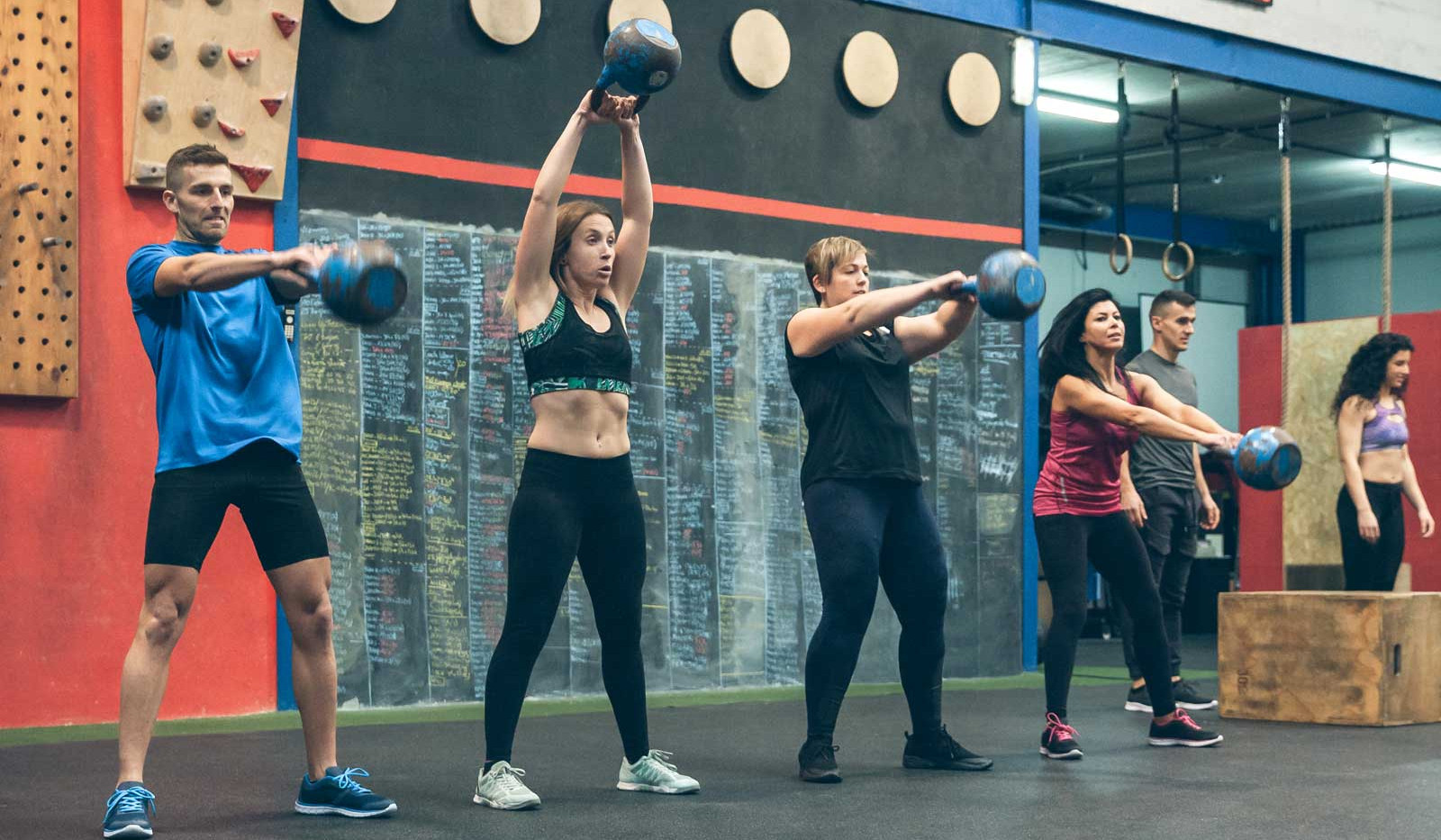 athletes-exercising-with-kettlebells-ind