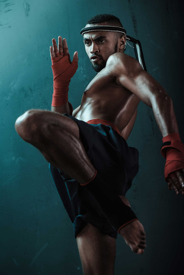 low-angle-view-of-determined-muay-thai-f